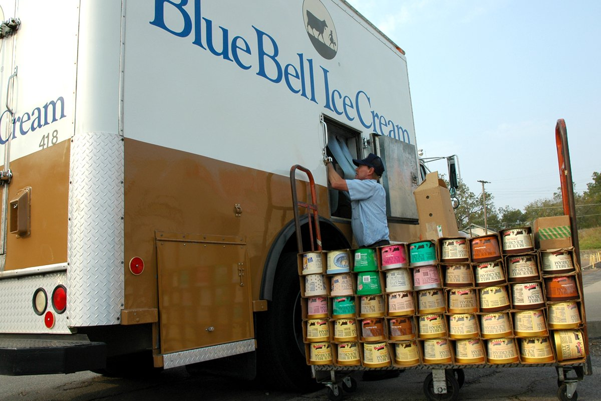 Employee unloading Blue Bell Ice Cream in a truck equipped with an Allison transmission.