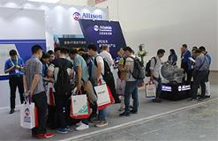 People surrounding booth showcasing xFE technology in China.