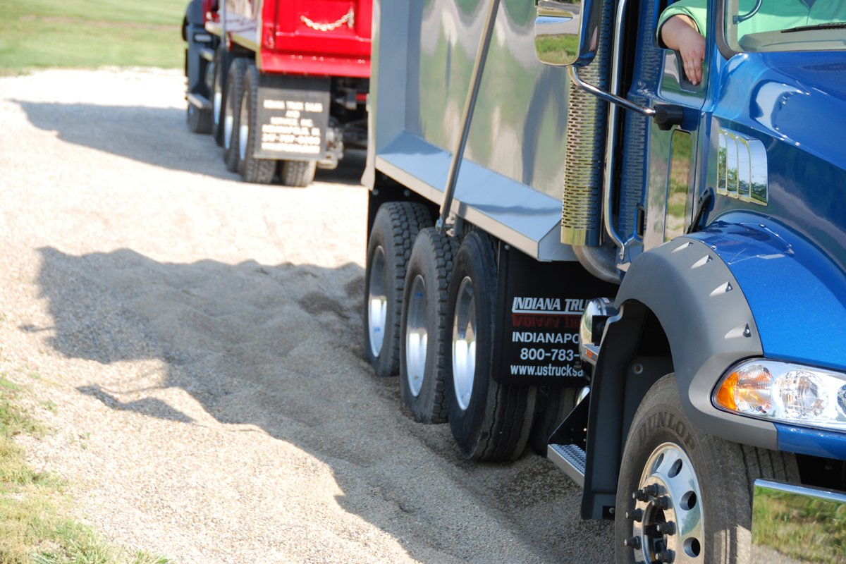 Trucks in pea gravel demonstrating benefits of an Allison transmission.