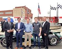 Representatives of Allison Transmission Holdings Inc. and the Indianapolis Motor Speedway standing in front of race car.