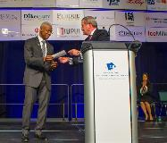 Dennis Bland (left), president of The Center for Leadership Development, is presented a $100,000 check from Allison Transmission by Chairman and CEO Larry Dewey.