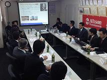 Employees at a meeting in Japan.